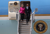 Democratic presidential candidate former Secretary of State Hillary Clinton walks off of Air Force One with US president Barack Obama on July 5 2016...