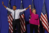 Democratic presidential candidate former Secretary of State Hillary Clinton and US president Barack Obama greet supporters during a campaign rally on...