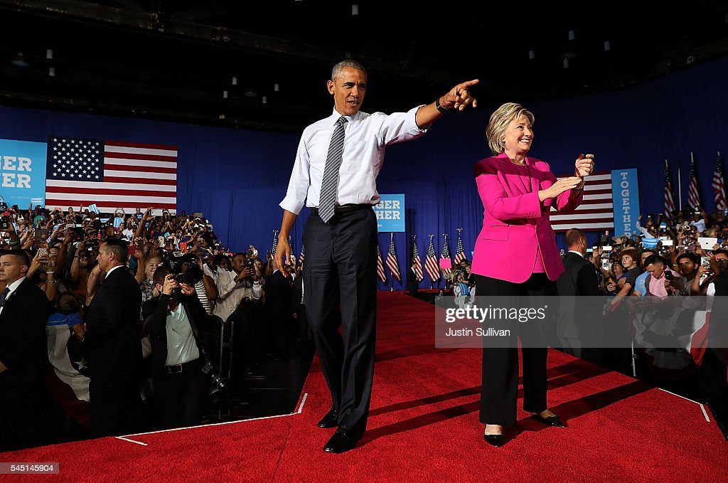 Democratic presidential candidate former Secretary of State Hillary Clinton (R) and U.S. president Barack Obama greet supporters during a campaign rally on July 5, 2016 in Charlotte, North Carolina. Hillary Clinton is campaigning with president Obama in North Carolina.