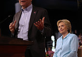 Democratic presidential candidate former Secretary of State Hillary Clinton looks on as her running mate Democratic vice presidential candidate US...