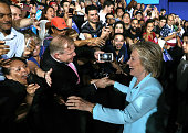 Democratic presidential candidate former Secretary of State Hillary Clinton greets supporters during a rally with Democratic vice presidential...