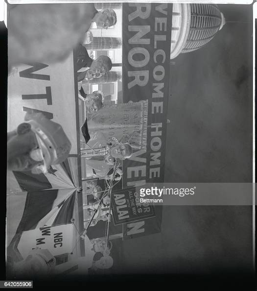 Democratic Presidential candidate Governor Adlai Stevenson of Illinois mops his brow in the sweltering heat that accompanies his welcome parade at...