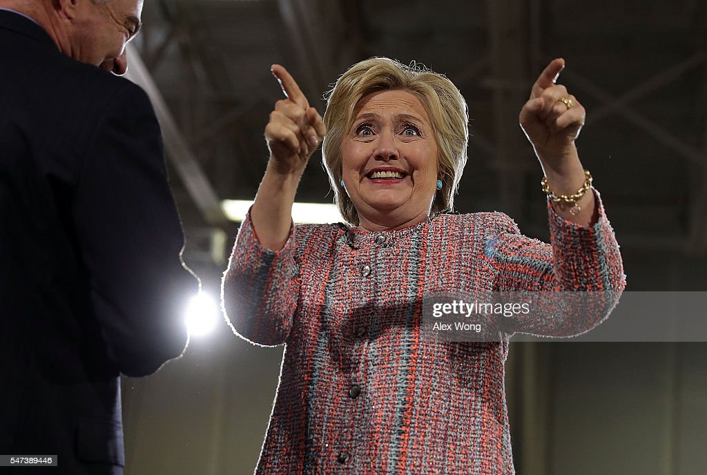 Democratic presidential candidate Hillary Clinton acknowledges the crowd as US Sen Tim Kaine looks on during a campaign event at Ernst Community...
