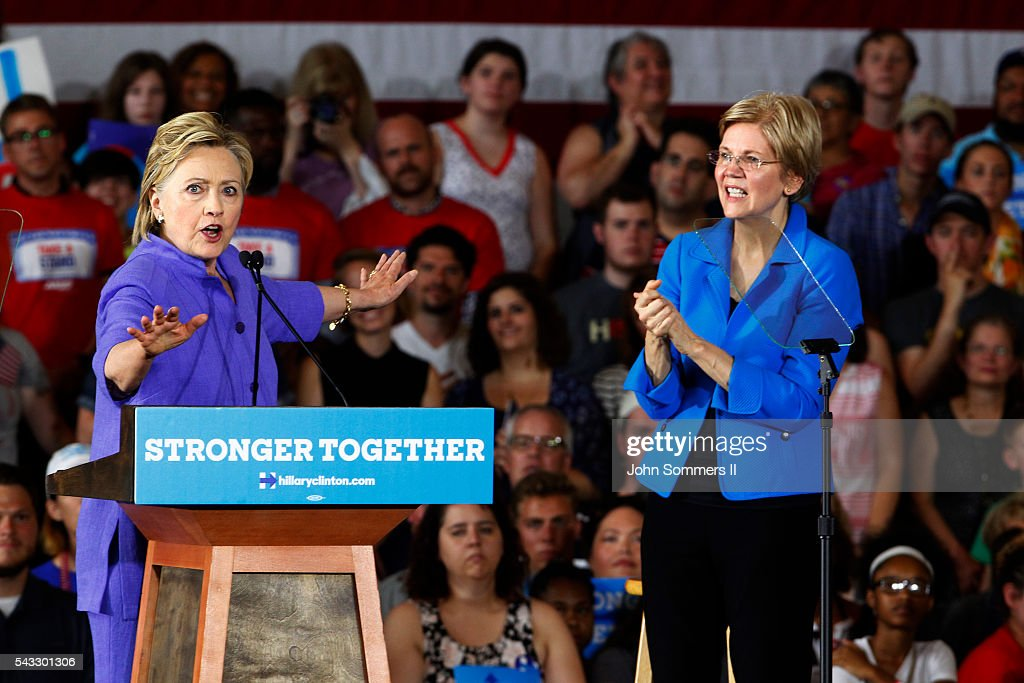 Democratic Presidential candidate <a gi-track='captionPersonalityLinkClicked' href=/galleries/search?phrase=Hillary+Clinton&family=editorial&specificpeople=76480 ng-click='$event.stopPropagation()'>Hillary Clinton</a> addresses the crowd as U.S. Sen <a gi-track='captionPersonalityLinkClicked' href=/galleries/search?phrase=Elizabeth+Warren&family=editorial&specificpeople=5396017 ng-click='$event.stopPropagation()'>Elizabeth Warren</a> (D-MA) (R) looks on during a campaign rally at the Cincinnati Museum Center at Union Terminal June 27, 2016 in Cincinnati, Ohio. Warren is helping Clinton campaign in Ohio.
