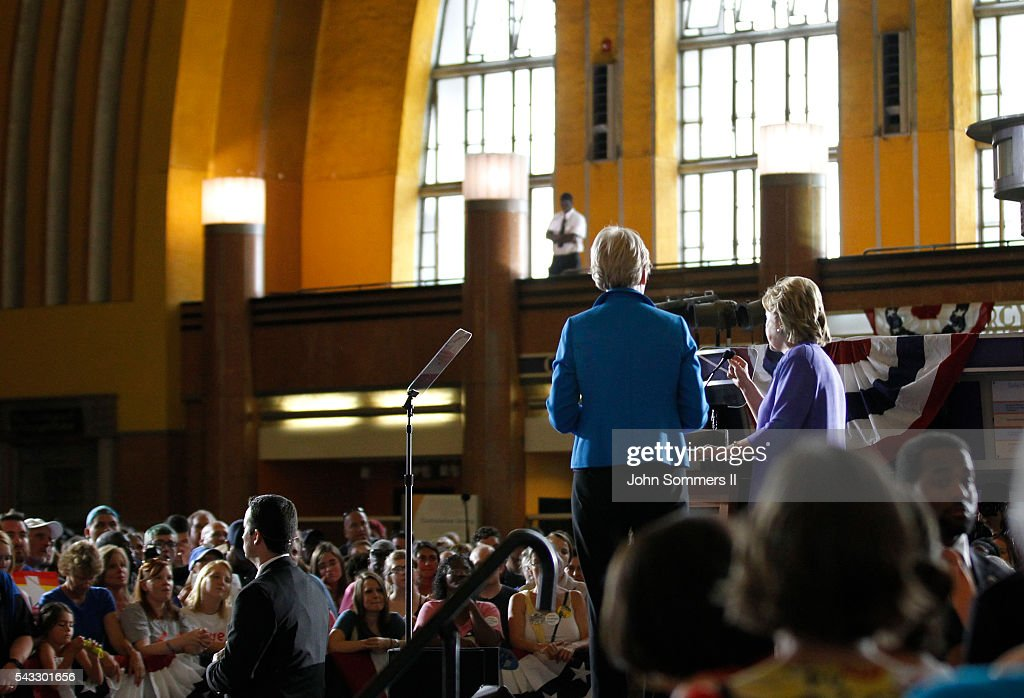 Democratic Presidential candidate <a gi-track='captionPersonalityLinkClicked' href=/galleries/search?phrase=Hillary+Clinton&family=editorial&specificpeople=76480 ng-click='$event.stopPropagation()'>Hillary Clinton</a> addresses the crowd as U.S. Sen <a gi-track='captionPersonalityLinkClicked' href=/galleries/search?phrase=Elizabeth+Warren&family=editorial&specificpeople=5396017 ng-click='$event.stopPropagation()'>Elizabeth Warren</a> (D-MA) (L) looks on during a campaign rally at the Cincinnati Museum Center at Union Terminal June 27, 2016 in Cincinnati, Ohio. Warren is helping Clinton campaign in Ohio.