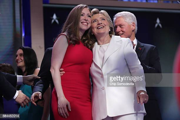 Democratic presidential candidate Hillary Clinton along with her daughter Chelsea Clinton acknowledge the crowd at the end on the fourth day of the...