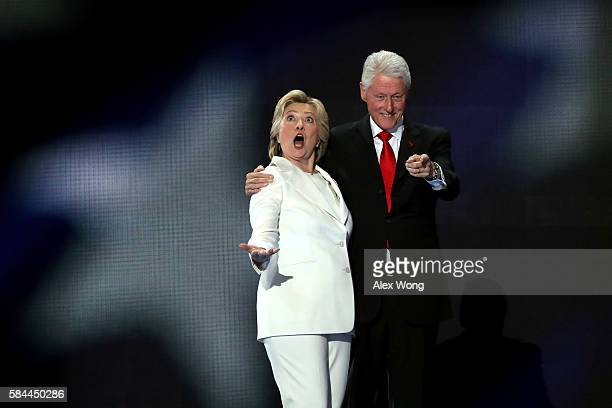 Democratic presidential candidate Hillary Clinton along with her husband former US President Bill Clinton acknowledge the crowd on the fourth day of...