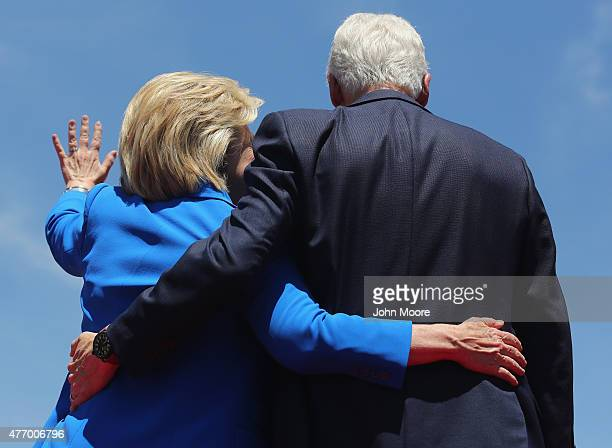 Democratic Presidential candidate Hillary Clinton and former President Bill Clinton embrace after Hillary officially launched her presidential...