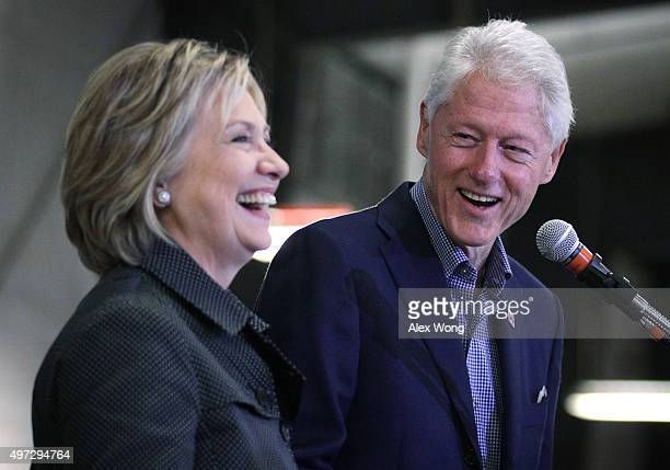 Democratic presidential candidate Hillary Clinton and her husband and former President Bill Clinton share a moment on stage during the Central Iowa...