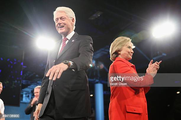 Democratic presidential candidate Hillary Clinton and her husband former president Bill Clinton greet guests at the end of the JeffersonJackson...