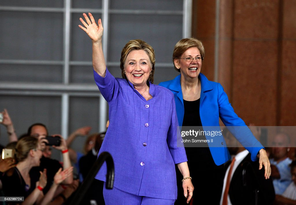 Democratic Presidential candidate <a gi-track='captionPersonalityLinkClicked' href=/galleries/search?phrase=Hillary+Clinton&family=editorial&specificpeople=76480 ng-click='$event.stopPropagation()'>Hillary Clinton</a> (L) and Senator <a gi-track='captionPersonalityLinkClicked' href=/galleries/search?phrase=Elizabeth+Warren&family=editorial&specificpeople=5396017 ng-click='$event.stopPropagation()'>Elizabeth Warren</a> (R) wave to the crowd before a campaign rally at the Cincinnati Museum Center at Union Terminal June 27, 2016 in Cincinnati, Ohio. Warren is helping Clinton campaign in Ohio.