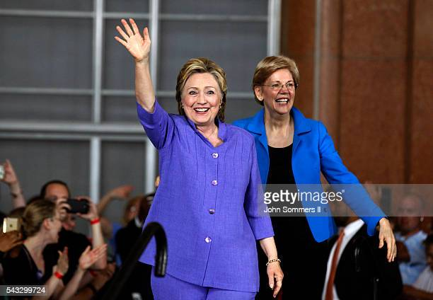 Democratic Presidential candidate Hillary Clinton and Senator Elizabeth Warren wave to the crowd before a campaign rally at the Cincinnati Museum...
