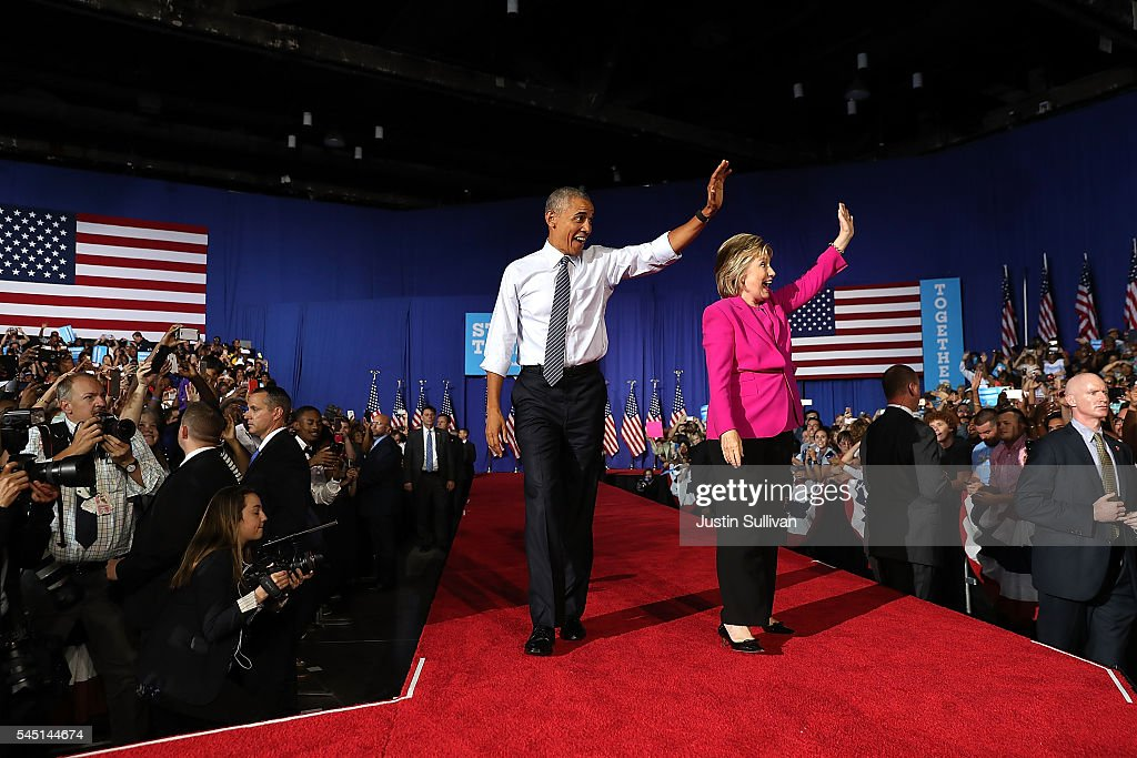 Democratic presidential candidate Hillary Clinton and U.S. President Barack Obama greet supporters during a campaign rally on July 5, 2016 in Charlotte, North Carolina. Today is President Obama's first appearance on the campaign trail with Clinton.
