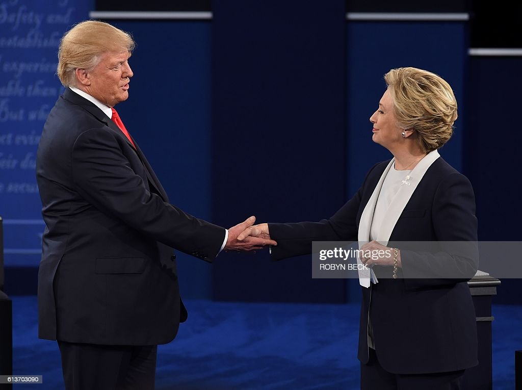 US Democratic presidential candidate Hillary Clinton (R) and US Republican presidential candidate Donald Trump shake hands at the end of the second presidential debate at Washington University in St. Louis, Missouri, on October 9, 2016. / AFP / Robyn Beck