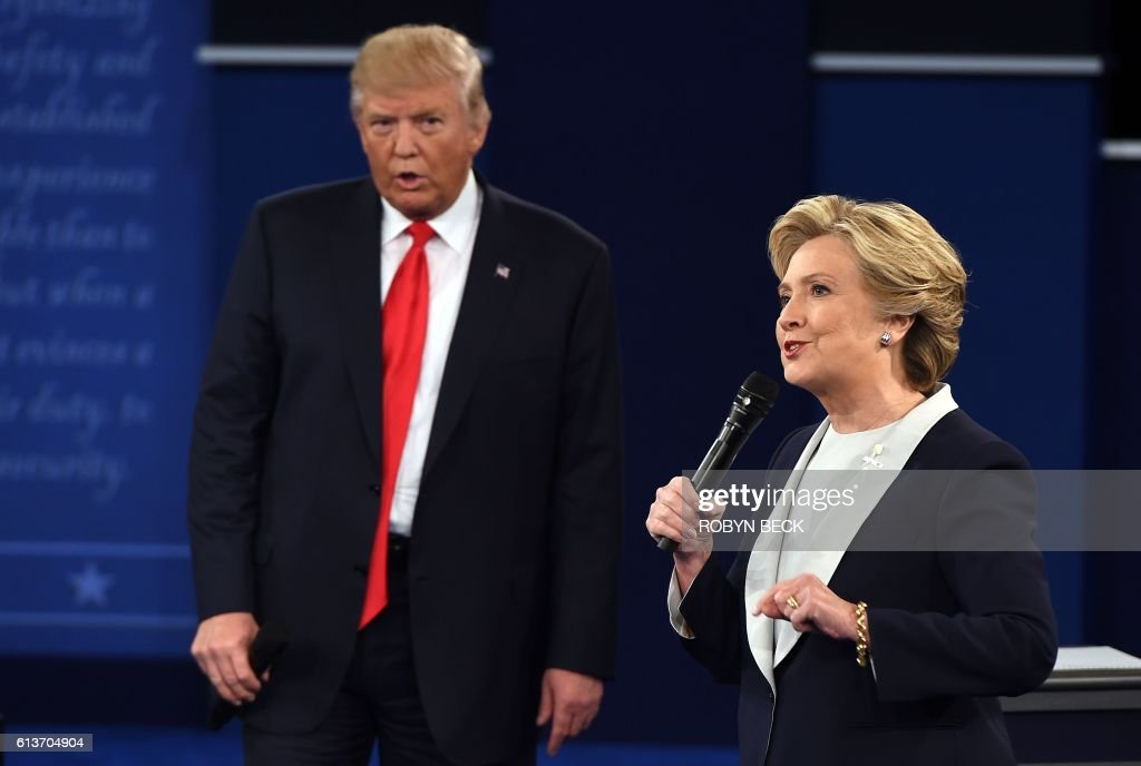 Democratic presidential candidate Hillary Clinton and US Republican presidential candidate Donald Trump debate during the second presidential debate at Washington University in St. Louis, Missouri, on October 9, 2016. / AFP / Robyn Beck