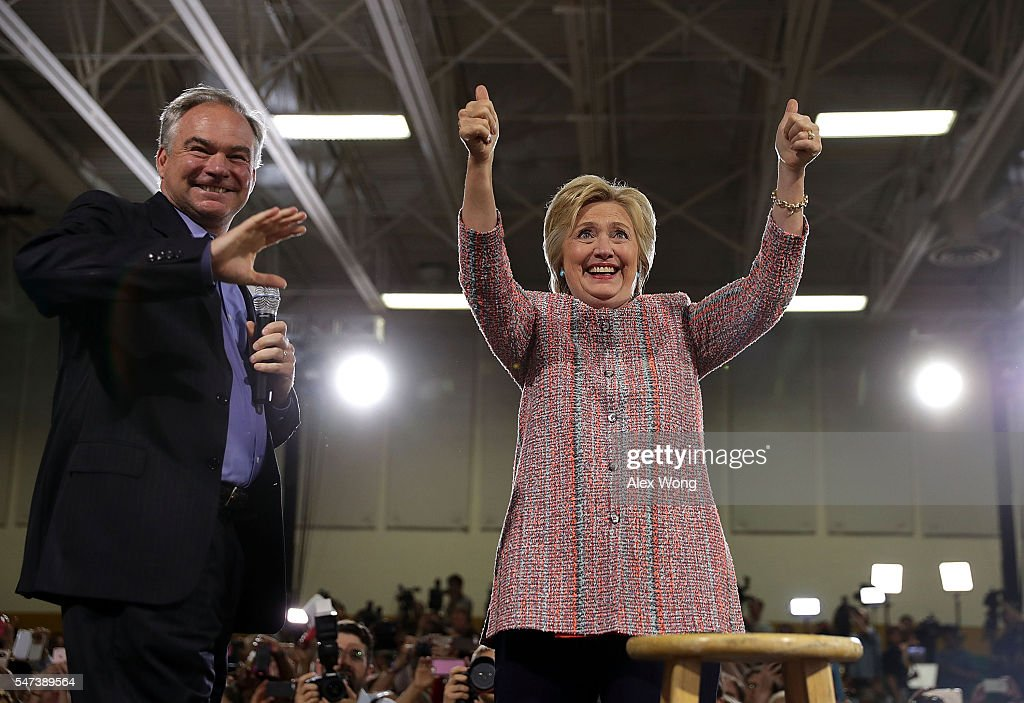Democratic presidential candidate Hillary Clinton and US Sen Tim Kaine acknowledge the crowd during a campaign event at Ernst Community Cultural...