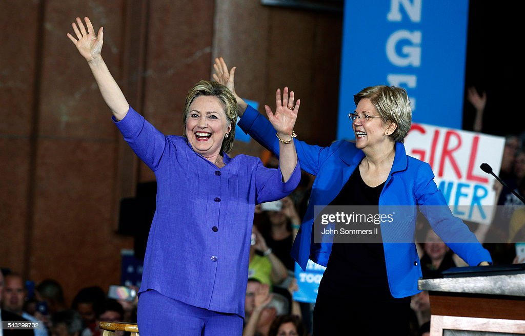 Democratic Presidential candidate <a gi-track='captionPersonalityLinkClicked' href=/galleries/search?phrase=Hillary+Clinton&family=editorial&specificpeople=76480 ng-click='$event.stopPropagation()'>Hillary Clinton</a> (L) and U.S. Sen <a gi-track='captionPersonalityLinkClicked' href=/galleries/search?phrase=Elizabeth+Warren&family=editorial&specificpeople=5396017 ng-click='$event.stopPropagation()'>Elizabeth Warren</a> (D-MA) (R) wave to the crowd before a campaign rally at the Cincinnati Museum Center at Union Terminal June 27, 2016 in Cincinnati, Ohio. Warren is helping Clinton campaign in Ohio.