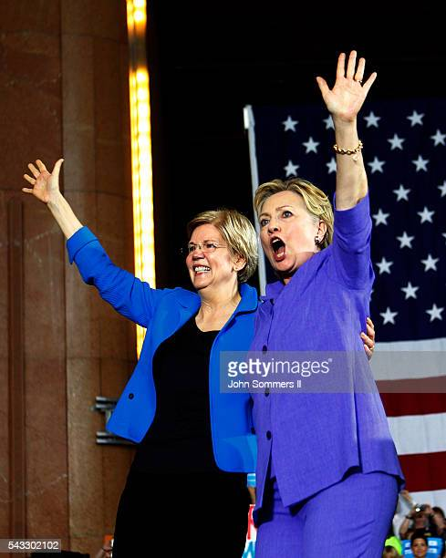 Democratic Presidential candidate Hillary Clinton and US Sen Elizabeth Warren wave to the crowd after a campaign rally at the Cincinnati Museum...