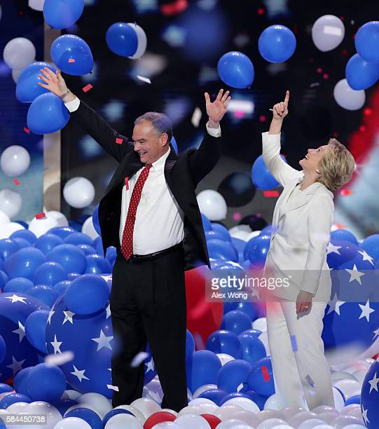 Democratic presidential candidate Hillary Clinton and US Vice President nominee Tim Kaine acknowledge the crowd at the end of the fourth day of the...