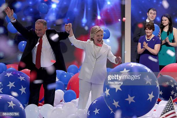 Democratic presidential candidate Hillary Clinton and US Vice President nominee Tim Kaine stand with their families at the end of the fourth day of...