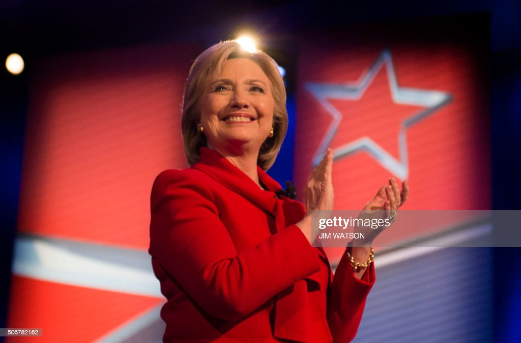 TOPSHOT - Democratic presidential candidate Hillary Clinton applauds during the CNN Town Hall at Drake University in Des Moines , Iowa, January 25, 2016, ahead of the Iowa Caucus.