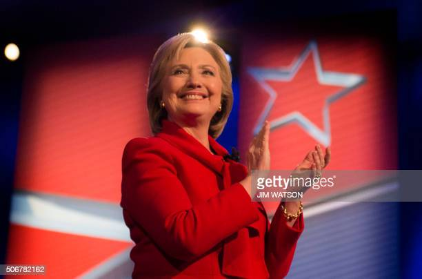 TOPSHOT Democratic presidential candidate Hillary Clinton applauds during the CNN Town Hall at Drake University in Des Moines Iowa January 25 ahead...