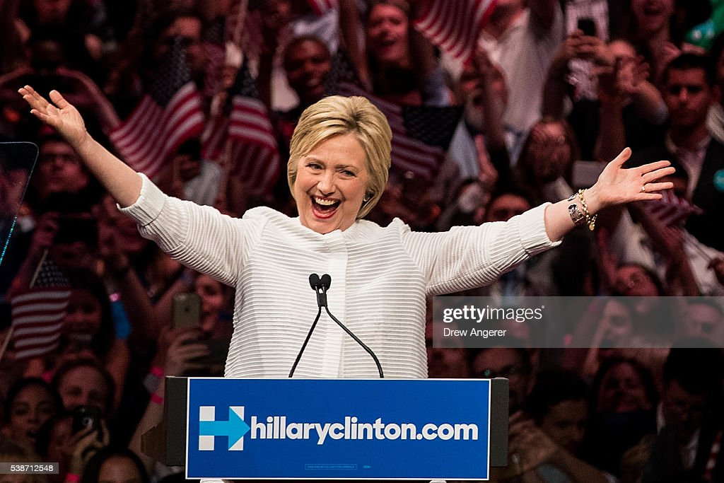 Democratic presidential candidate <a gi-track='captionPersonalityLinkClicked' href=/galleries/search?phrase=Hillary+Clinton&family=editorial&specificpeople=76480 ng-click='$event.stopPropagation()'>Hillary Clinton</a> arrives onstage during a primary night rally at the Duggal Greenhouse in the Brooklyn Navy Yard, June 7, 2016 in the Brooklyn borough of New York City. Clinton has secured enough delegates and commitments from superdelegates to become the Democratic Party's presumptive presidential nominee. She will become the first woman in U.S. history to secure the presidential nomination of one of the country's two major political parties.