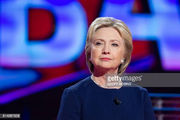 Democratic presidential candidate Hillary Clinton awaits the start of the Democratic Debate in Flint Michigan March 6 2016 / AFP / Geoff Robins
