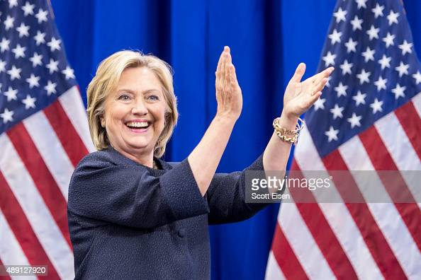 Democratic presidential candidate Hillary Clinton claps on stage during the New Hampshire Democratic Party Convention at the Verizon Wireless Center...