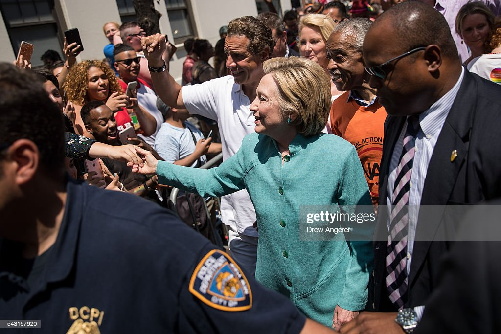 Democratic presidential candidate Hillary Clinton, flanked by New York Governor Andrew Cuomo and Rev. Al Sharpton, attends the New York City Gay Pride Parade, June 26, 2016 in New York City. Over 30,000 people marched in the 46th annual parade.