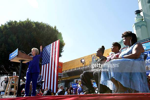 Democratic presidential candidate Hillary Clinton gives a speech as Wanda Jackson from right mother of Oscar Grant Gwen Carr mother of Eric Garner...