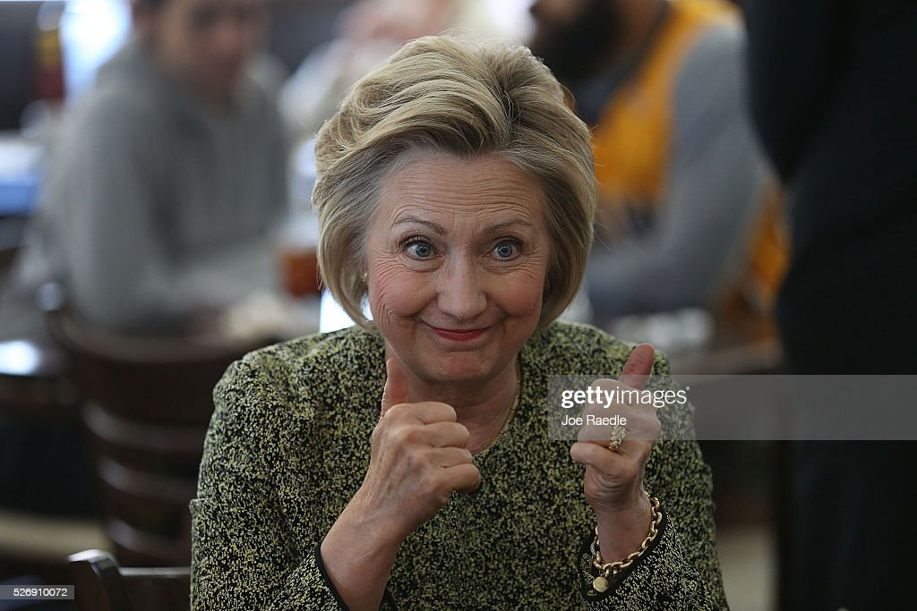 Democratic presidential candidate <a gi-track='captionPersonalityLinkClicked' href=/galleries/search?phrase=Hillary+Clinton&family=editorial&specificpeople=76480 ng-click='$event.stopPropagation()'>Hillary Clinton</a> gives a thumbs up during a stop at the Lincoln Square pancake house as she campaign for votes on May 1, 2016 in Indianapolis, Indiana. Presidential candidates continue to campaign across the state leading up to Indiana's primary day on Tuesday.