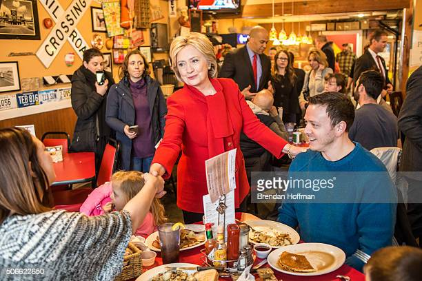 Democratic presidential candidate Hillary Clinton greets diners at Riley's Cafe on January 24 2016 in Cedar Rapids Iowa The Democratic and Republican...