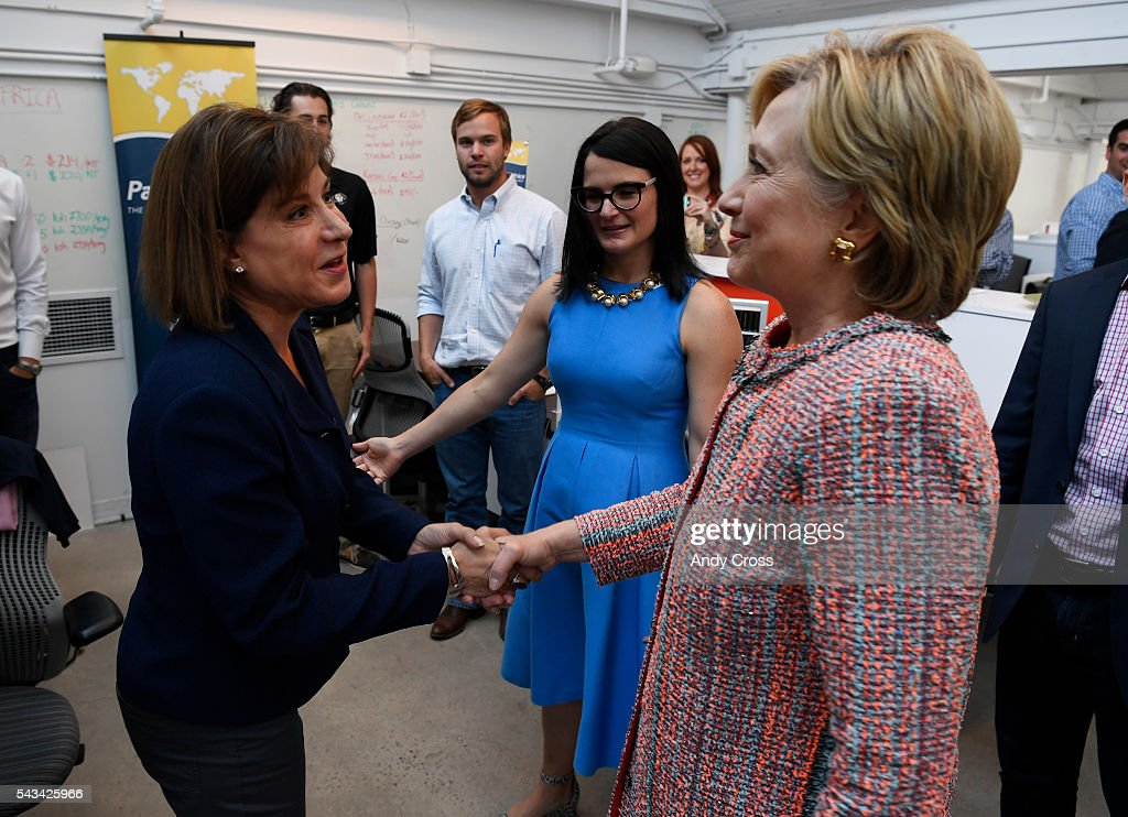 Democratic Presidential candidate <a gi-track='captionPersonalityLinkClicked' href=/galleries/search?phrase=Hillary+Clinton&family=editorial&specificpeople=76480 ng-click='$event.stopPropagation()'>Hillary Clinton</a> greets PanXchange CEO Julie Lerner, left, during a campaign stop at Galvanize June 28, 2016.