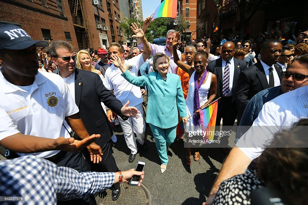 Democratic Presidential candidate Hillary Clinton (C) greets people as she marches in the 46th annual New York City Gay Pride Parade in New York, New York, USA, on 26 June 2016.
