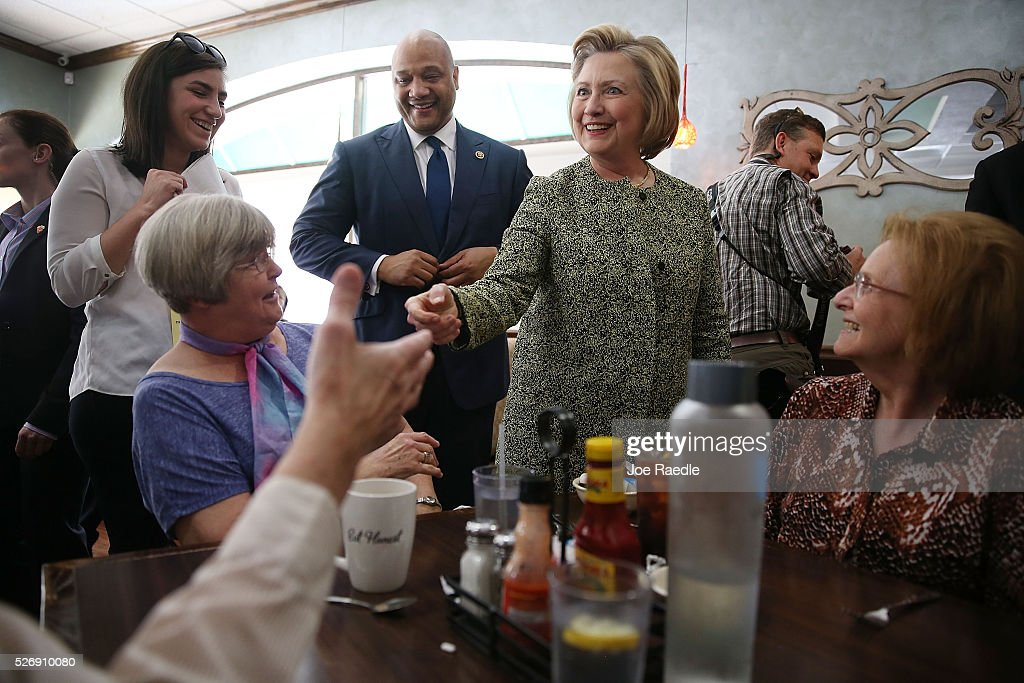 Democratic presidential candidate <a gi-track='captionPersonalityLinkClicked' href=/galleries/search?phrase=Hillary+Clinton&family=editorial&specificpeople=76480 ng-click='$event.stopPropagation()'>Hillary Clinton</a> greets people at the Lincoln Square pancake house as she campaign for votes on May 1, 2016 in Indianapolis, Indiana. Presidential candidates continue to campaign across the state leading up to Indiana's primary day on Tuesday.