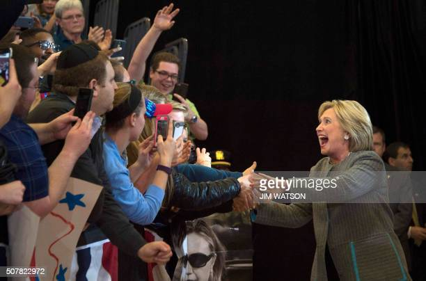 Democratic presidential candidate Hillary Clinton greets supporters as she arrives to speak at Abraham Lincoln High School in Des Moines Iowa January...