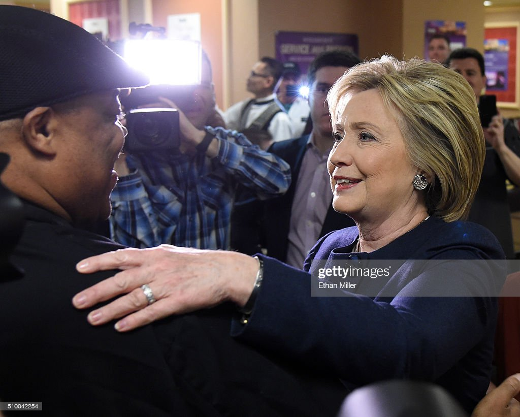 Democratic presidential candidate <a gi-track='captionPersonalityLinkClicked' href=/galleries/search?phrase=Hillary+Clinton&family=editorial&specificpeople=76480 ng-click='$event.stopPropagation()'>Hillary Clinton</a> (R) greets workers during a visit to employee dining room at Harrah's Las Vegas on February 13, 2016 in Las Vegas, Nevada. Clinton is challenging Sen. Bernie Sanders for the Democratic presidential nomination ahead of Nevada's Feb. 20 Democratic caucus.