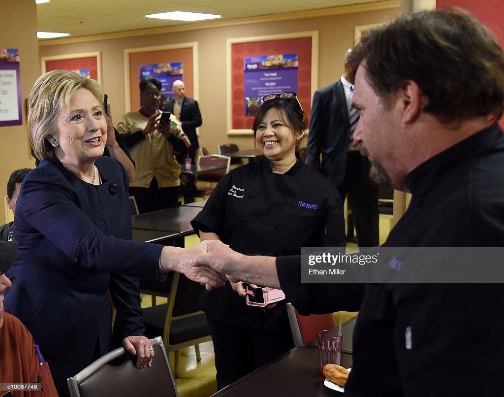 Democratic presidential candidate <a gi-track='captionPersonalityLinkClicked' href=/galleries/search?phrase=Hillary+Clinton&family=editorial&specificpeople=76480 ng-click='$event.stopPropagation()'>Hillary Clinton</a> (L) greets workers as she visits an employee dining room at Harrah's Las Vegas on February 13, 2016 in Las Vegas, Nevada. Clinton is challenging Sen. Bernie Sanders for the Democratic presidential nomination ahead of Nevada's Feb. 20 Democratic caucus.