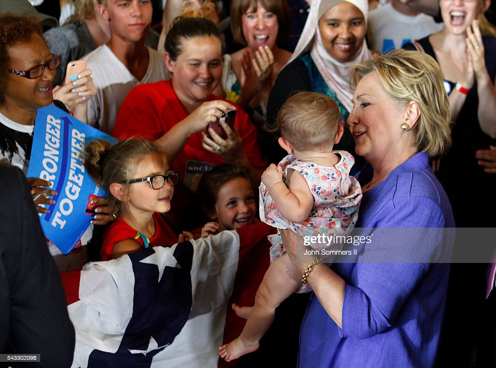 Democratic Presidential candidate <a gi-track='captionPersonalityLinkClicked' href=/galleries/search?phrase=Hillary+Clinton&family=editorial&specificpeople=76480 ng-click='$event.stopPropagation()'>Hillary Clinton</a> holds a baby from the crowd after her speech at campaign rally at the Cincinnati Museum Center at Union Terminal June 27, 2016, in Cincinnati, Ohio. U.S. Sen Elizabeth Warren (D-MA) is helping Clinton campaign in Ohio.