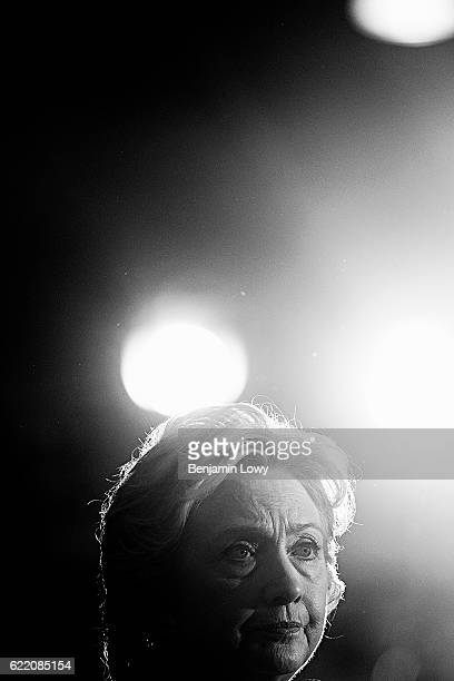 Democratic presidential candidate Hillary Clinton holds up a book as she speaks during a campaign rally at the Sunrise Theatre on September 30 2016...