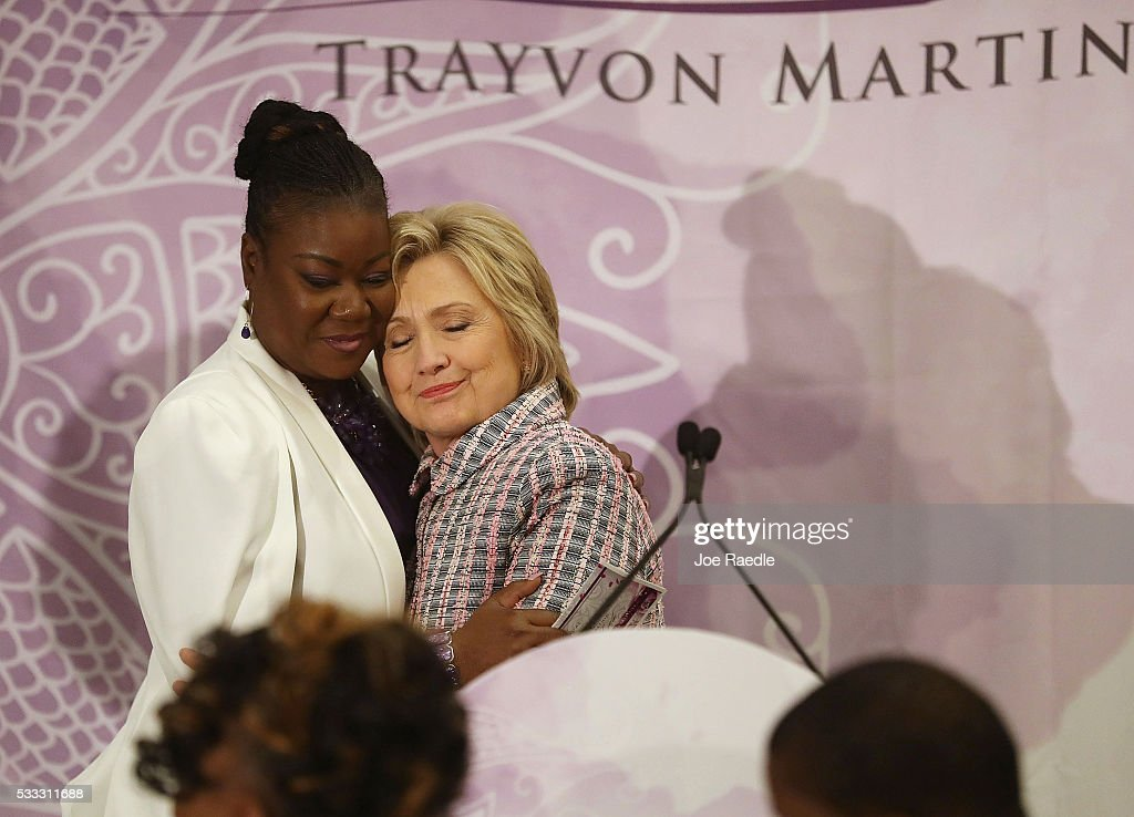 Democratic presidential candidate Hillary Clinton hugs Sybrina Fulton, mother of Trayvon Martin who was fatally shot by neighborhood watch volunteer George Zimmerman in 2012, as she speaks before the third annual Circle of Mothers conference on May 21, 2016 in Fort Lauderdale, Florida. Hillary Clinton continues to campaign for the Democratic presidential nomination.