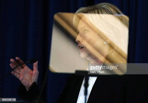 Democratic presidential candidate Hillary Clinton is seen through a telepromter as she speaks about relations with Israel and the situation with ISIS...