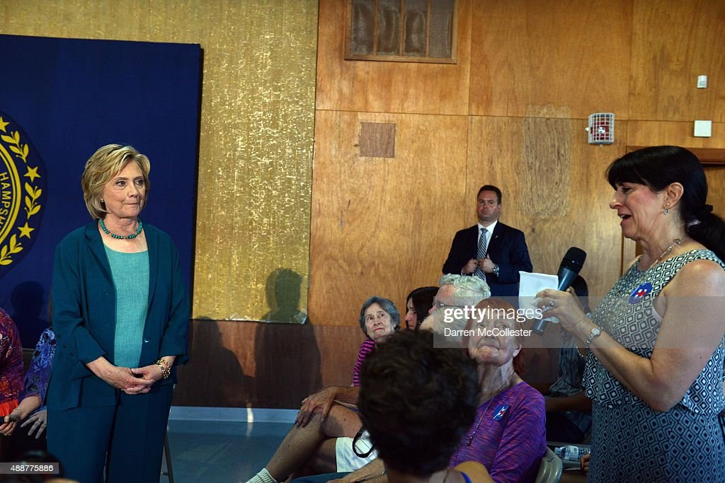 Democratic Presidential candidate Hillary Clinton listens as Cindie Graham talks about losing a loved one to drugs during a community forum on substance abuse September 17, 2015 in Laconia, New Hampshire. Clinton spent the day campaigning in the first in the nation primary state ahead of this weekends New Hampshire State Democratic Convention.
