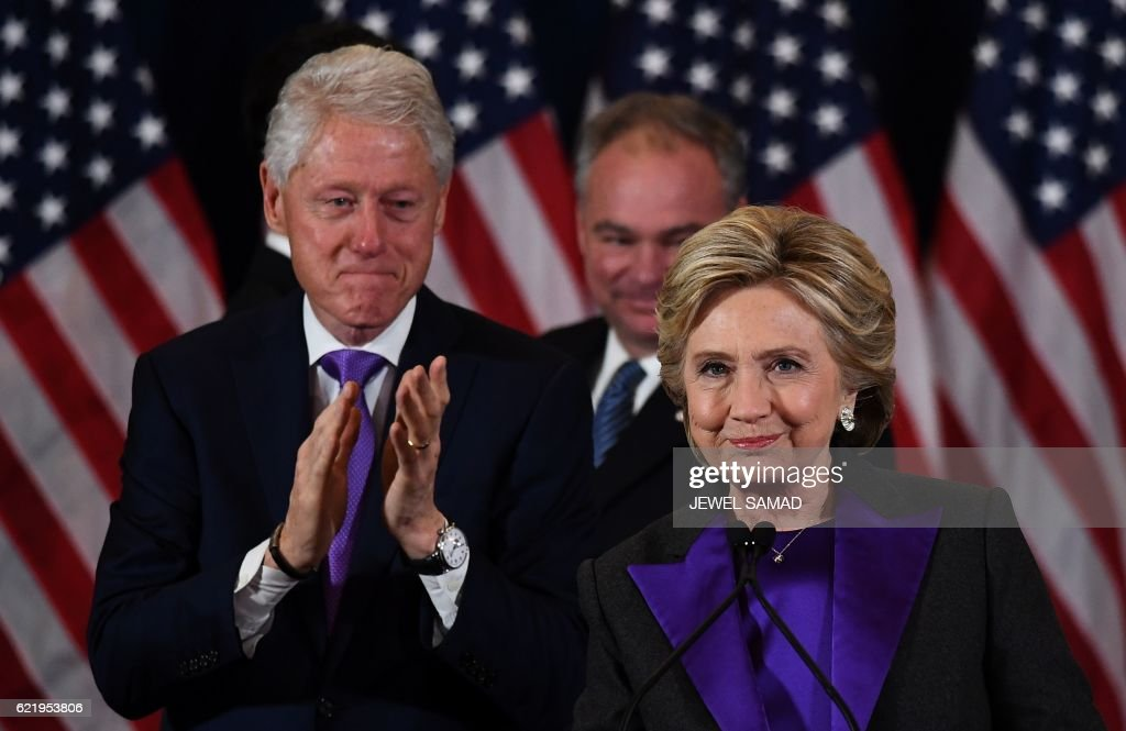 Democratic presidential candidate Hillary Clinton makes a concession speech after being defeated by Republican president-elect Donald Trump as former President Bill Clinton(L) and running mate Tim Kaine look on in New York on November 9, 2016. /