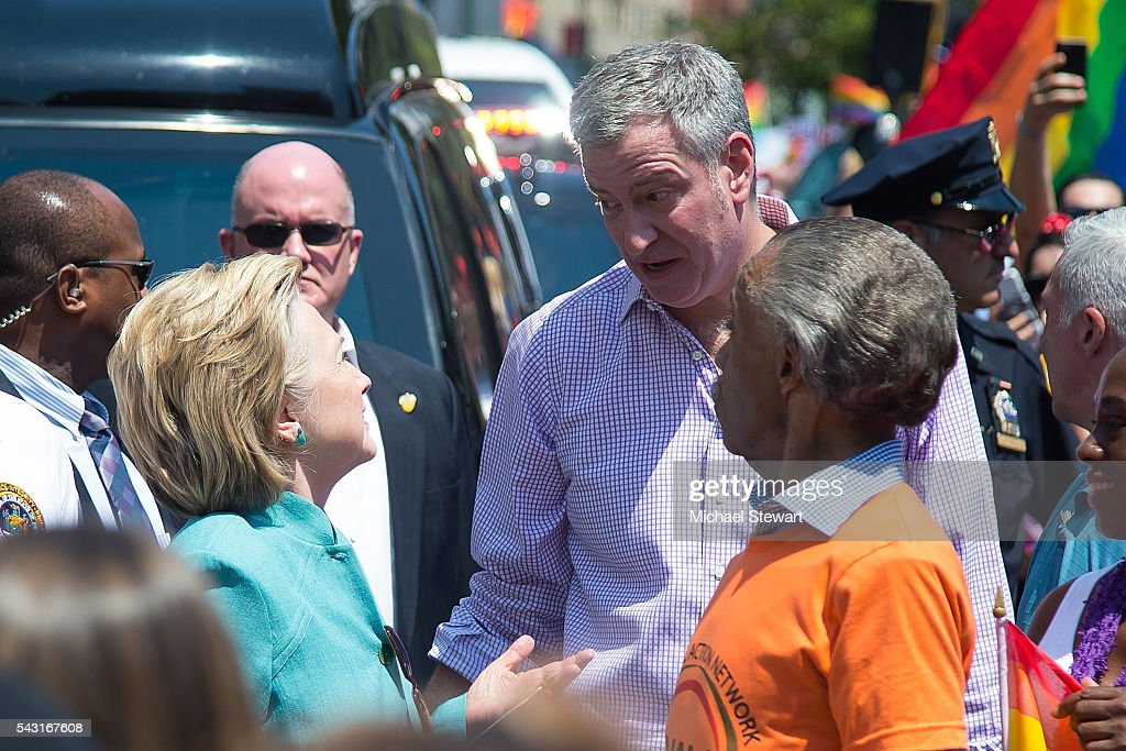 Democratic Presidential candidate HIllary Clinton, New York City Mayor <a gi-track='captionPersonalityLinkClicked' href=/galleries/search?phrase=Bill+de+Blasio&family=editorial&specificpeople=6224514 ng-click='$event.stopPropagation()'>Bill de Blasio</a> and Reverend <a gi-track='captionPersonalityLinkClicked' href=/galleries/search?phrase=Al+Sharpton&family=editorial&specificpeople=202250 ng-click='$event.stopPropagation()'>Al Sharpton</a> attend the 2016 Pride March on June 26, 2016 in New York City.