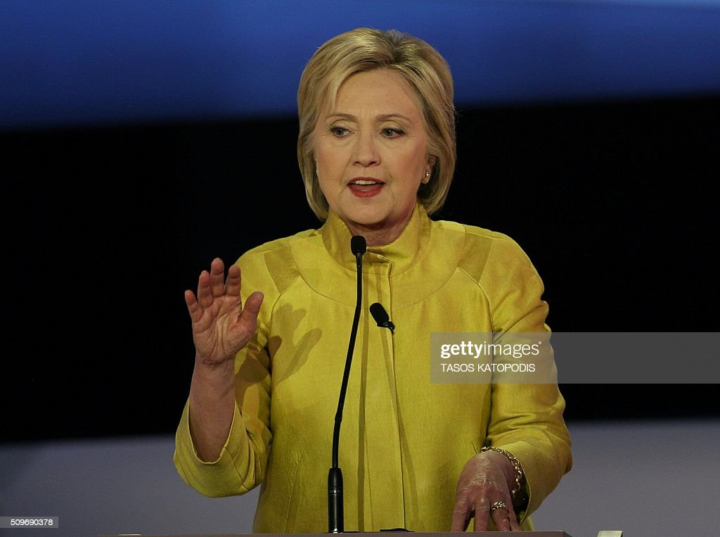 US Democratic presidential candidate Hillary Clinton participates in the PBS NewsHour Presidential Primary Debate with Bernie Sanders in Milwaukee...