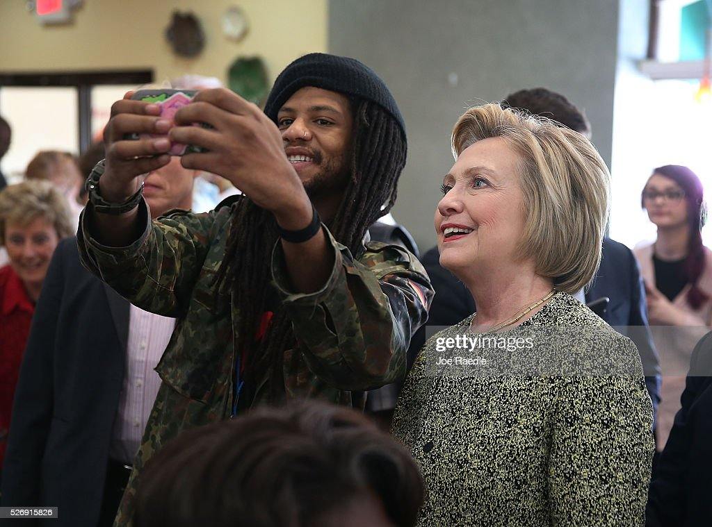 Democratic presidential candidate Hillary Clinton poses for a cell phone pictures as she greets people at the Lincoln Square pancake house as she campaign for votes on May 1, 2016 in Indianapolis, Indiana. Presidential candidates continue to campaign across the state leading up to Indiana's primary day on May 3.