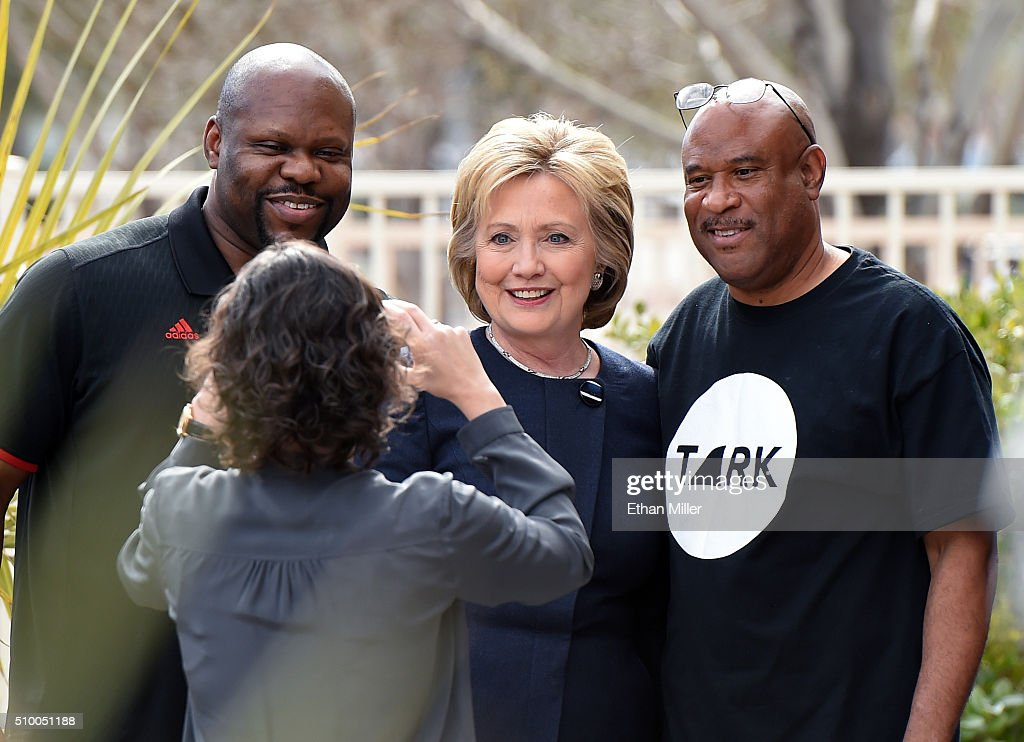 Democratic presidential candidate <a gi-track='captionPersonalityLinkClicked' href=/galleries/search?phrase=Hillary+Clinton&family=editorial&specificpeople=76480 ng-click='$event.stopPropagation()'>Hillary Clinton</a> (C) poses for a photo outside the Gritz Cafe on February 13, 2016 in Las Vegas, Nevada. Clinton is challenging Sen. Bernie Sanders for the Democratic presidential nomination ahead of Nevada's Feb. 20 Democratic caucus.