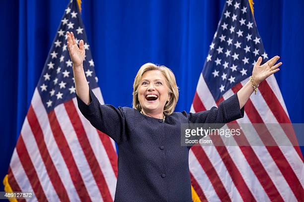 Democratic presidential candidate Hillary Clinton raises her arms stands on stage during the New Hampshire Democratic Party Convention at the Verizon...